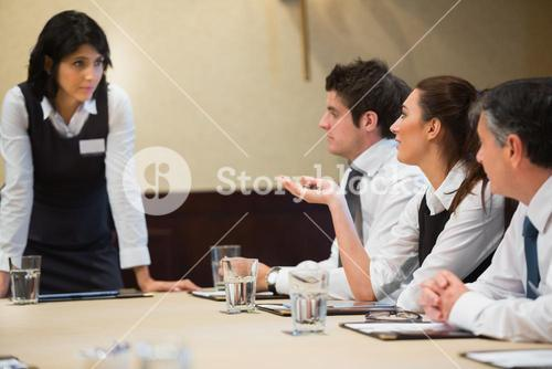 Woman asking question in business meeting