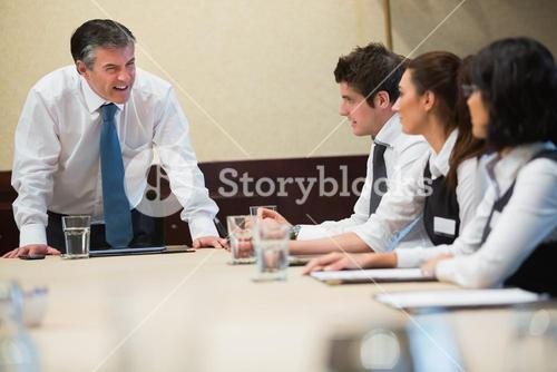 Angry boss in business meeting