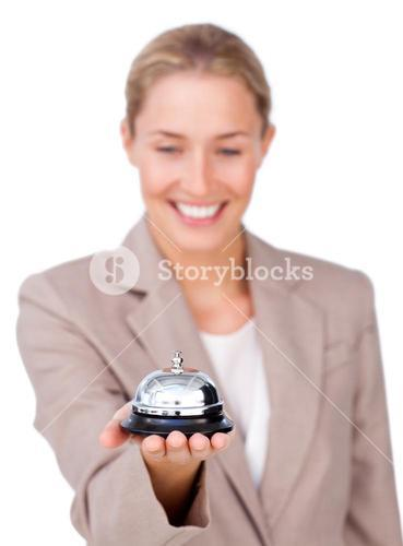 Attractive businesswoman holding a service bell