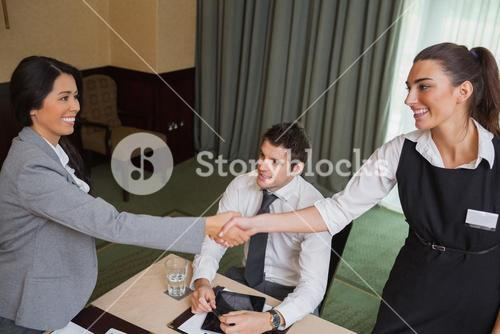 Women shaking hands during business meeting