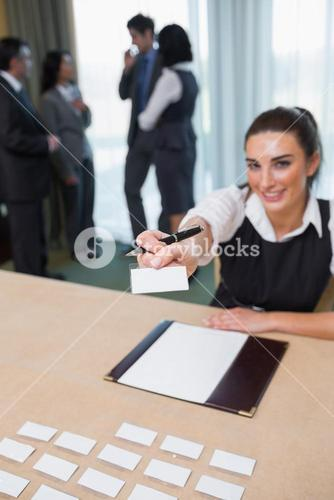 Woman handing you a name tag