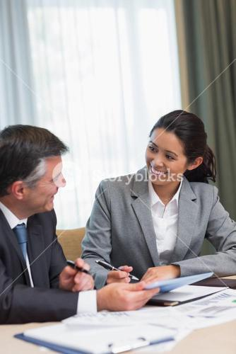 Business people happily talking