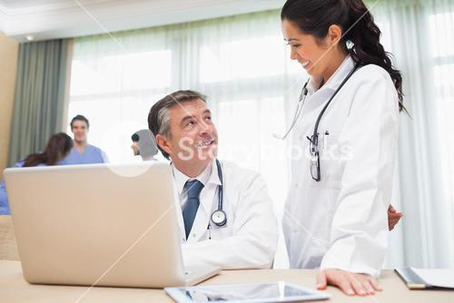 Two doctors chatting