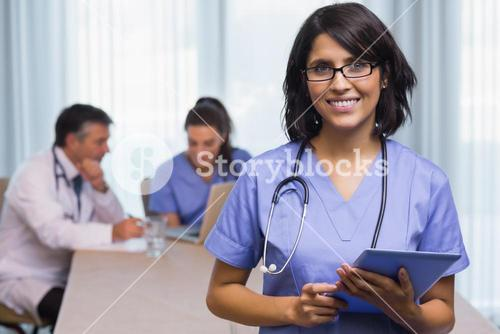 Smiling nurse with tablet pc