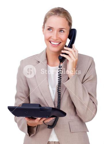 Enthusiastic businesswoman pointing at a copyspace
