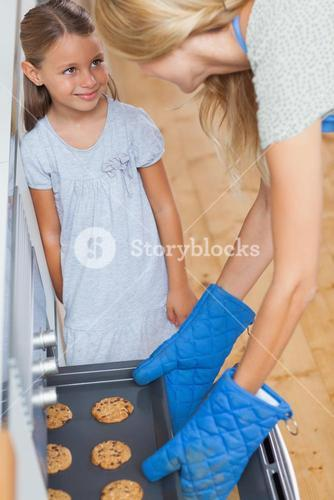 Mother and her daughter taking cookies