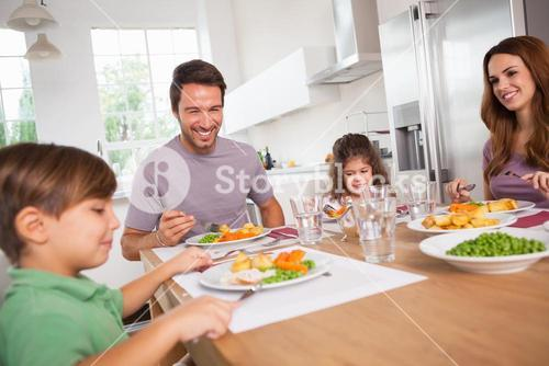 Family smiling around a good meal