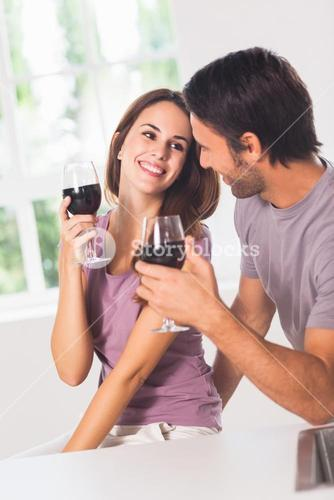 Smiling couple with wine