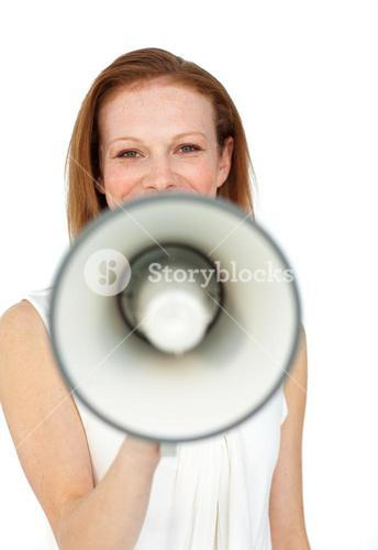 Smiling businesswoman using a megaphone