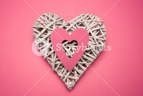 Wicker heart ornament with paper cut out