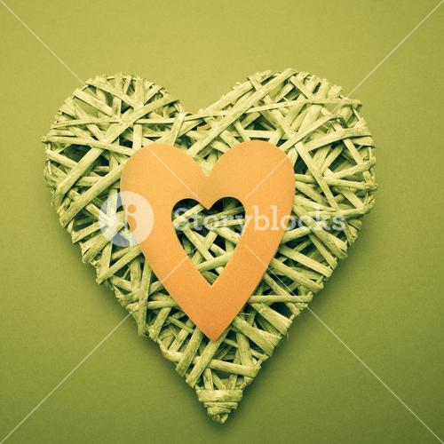 Wicker heart ornament with yellow paper cut out