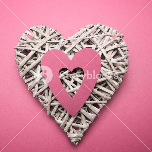 Wicker heart ornament with pink paper cut out