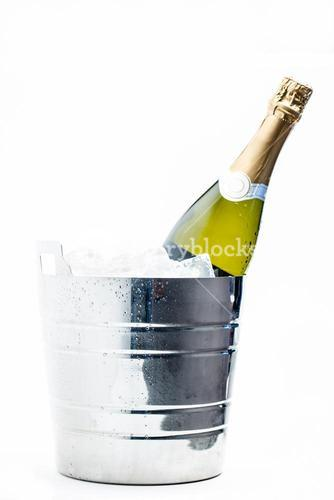 Bottle of champagne chilling in ice bucket