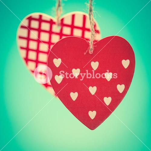 Two hanging heart ornaments