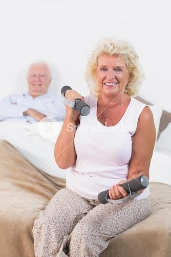 Old woman lifting weights