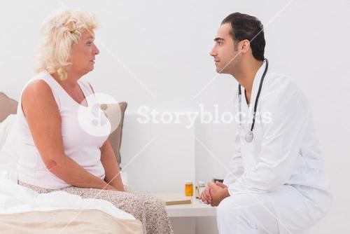 Old woman consulting a doctor