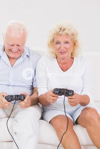 Old couple playing video games