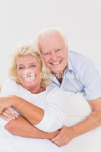 Smiling old couple hugging