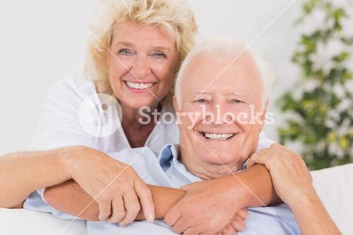 Happy old couple portrait hugging