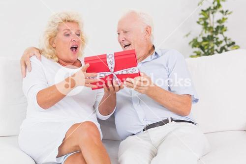 Surprising old woman receiving a gift