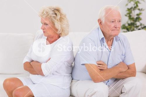 Unhappy woman being angry against an old man