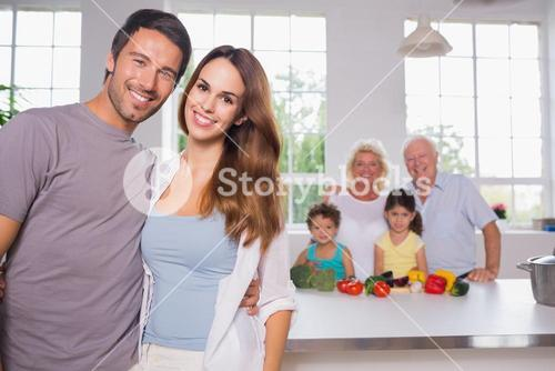 Parents in front of their family