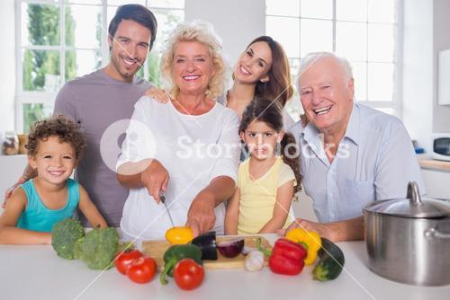 Multigeneration family cutting vegetables together