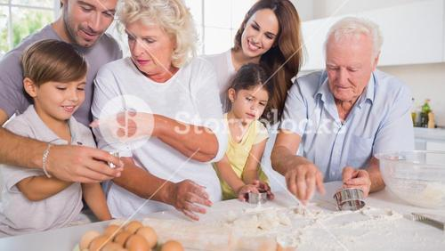 Multigeneration family baking together