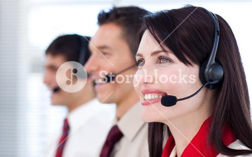 Happy coworkers with headsets on