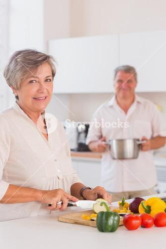 Old lovers preparing food