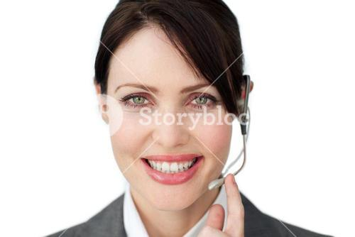 Radiant businesswoman holding a phone