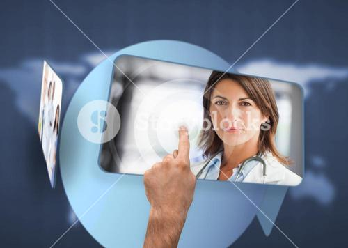 Hand selecting image of doctor from digital interface