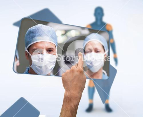 Hand selecting image of surgeons from digital interface