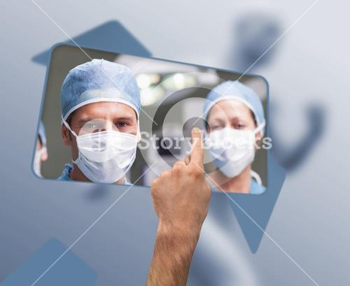 Hand selecting image of surgeons