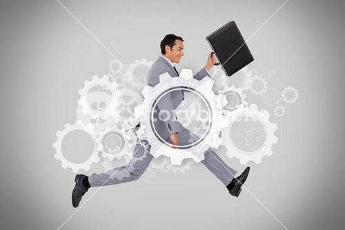 Businessman running with briefcase on grey background