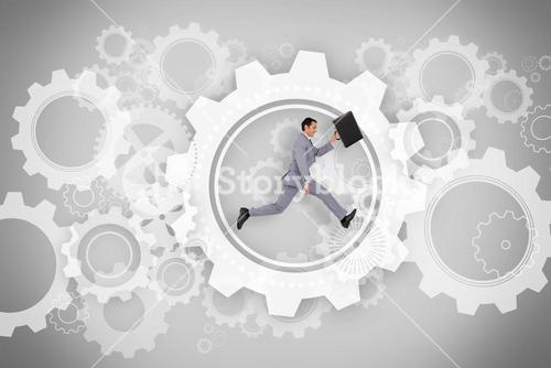 Businessman running with briefcase with wheels and cogs graphic