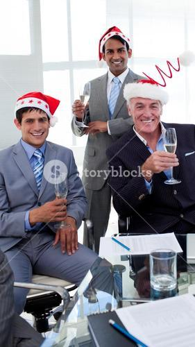 Confident businessmen wearing novelty Christmas hat