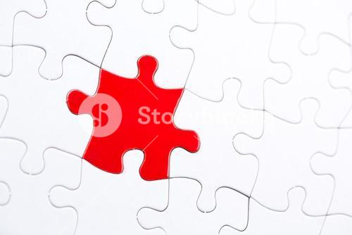 White jigsaw puzzle with one red piece