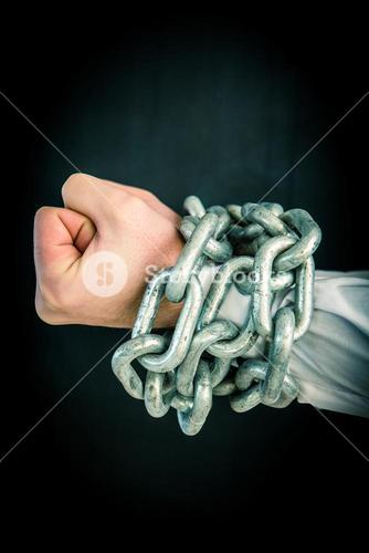 Hands wrapped in chains