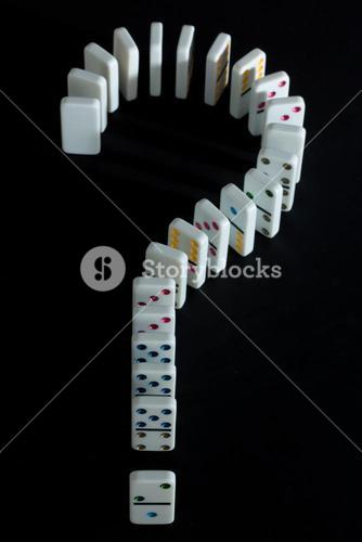 Dominoes shaped into question mark
