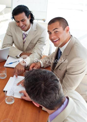 Smiling business coworkers in a meeting