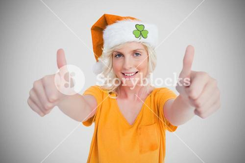 Girl in orange tshirt giving thumbs up