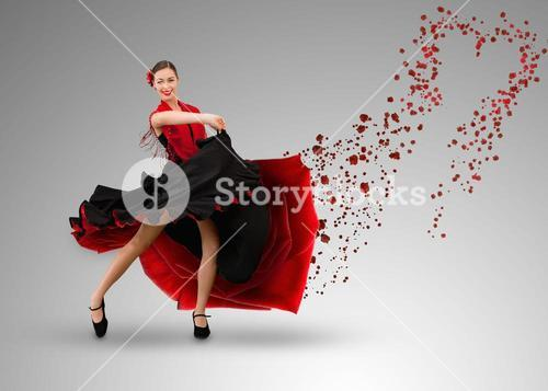 Smiling flamenco dancer with heart shaped paint splatter coming from dress
