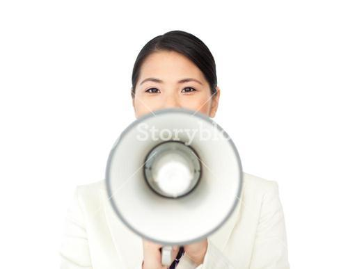 Young businesswoman shouting through a megaphone