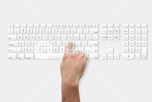 Hand pressing l key on keyboard