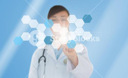 Brunette doctor pressing touchscreen