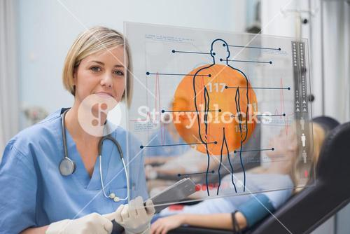 Nurse looking an interface during a blood donation