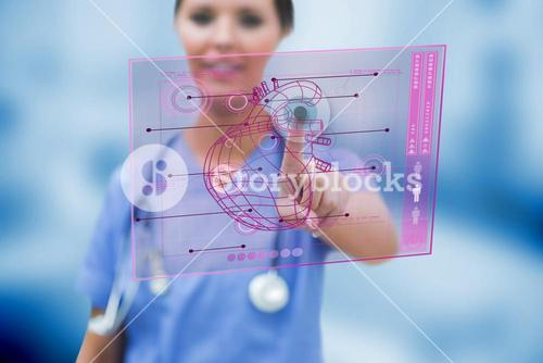 Cardiologist touching a medical interface