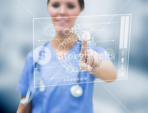 Female cardiologist touching a medical interface