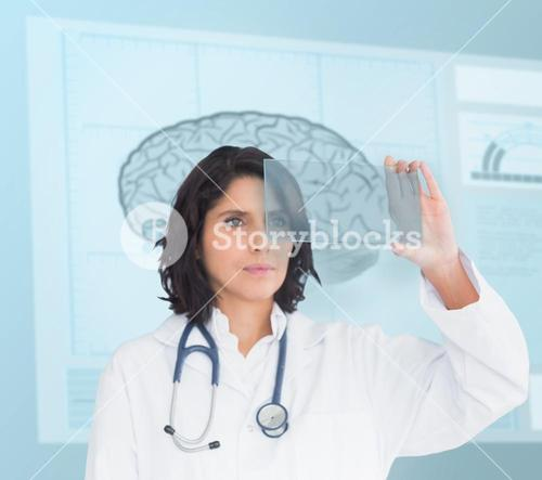 Doctor using a new technology in front of brain sketch